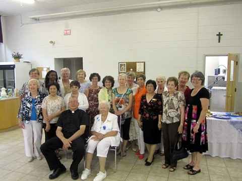 Father Michael with ladies of the CWL