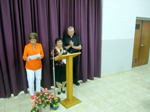 CWL President Vicki Elatico thanks Father Michael