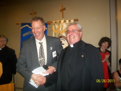 Monsignor Pizzacalla wins dinner for two!